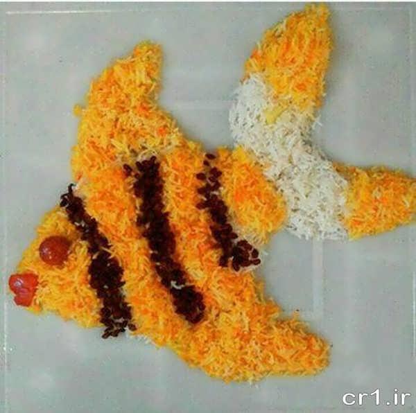 تزیین برنج به شکل ماهی با زعفران و زرشک